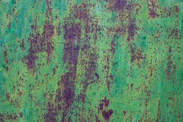 Metal of a metal door, weathered in southern Spain