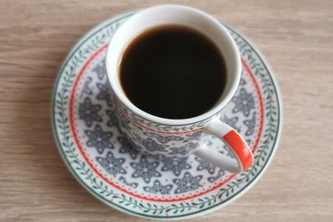 Top view image of a cup of black coffee