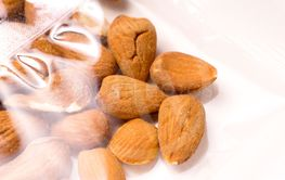 almonds packages in plastic packaging on white
