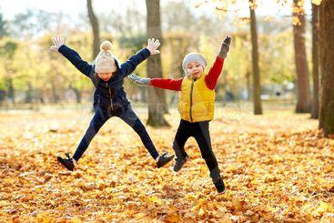 happy children running at autumn park