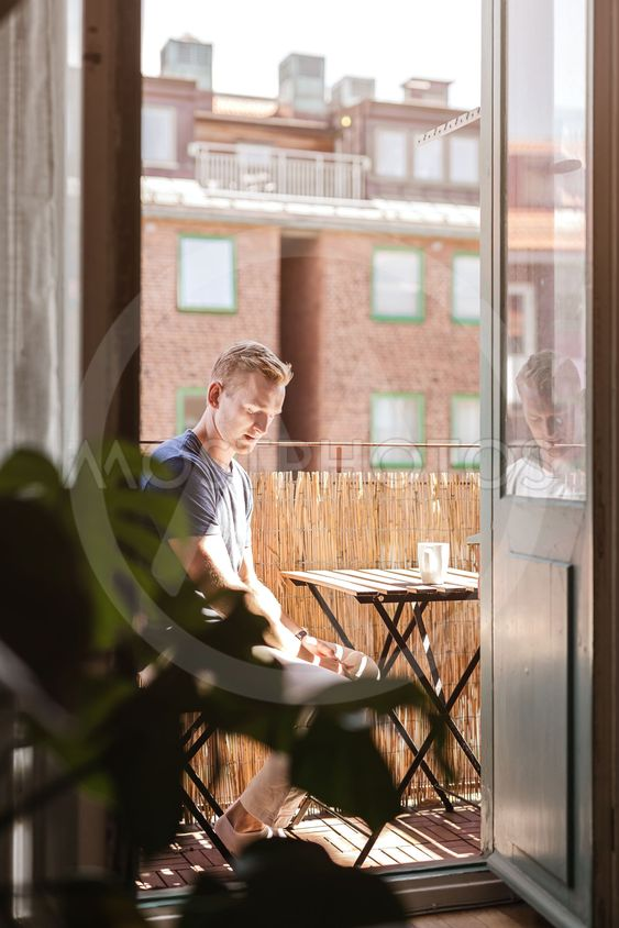 Calm man drinking coffee in the morning