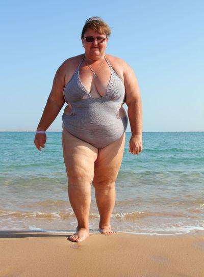 overweight woman on beach