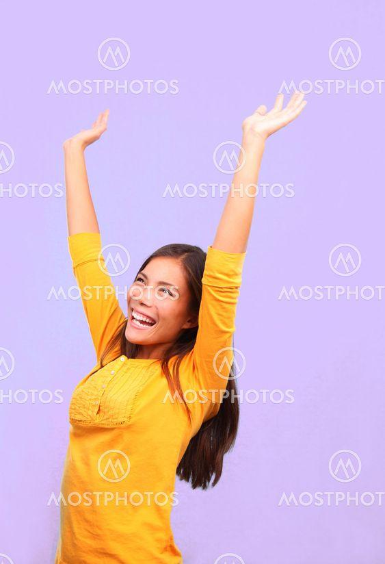 Happy winner asian woman