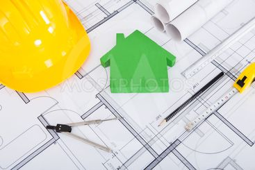 Tools; Hardhat And Model House On Blueprint