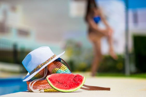Summer concept- tasty watermelon, straw bag and juice...