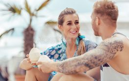 Young couple holding coconut water