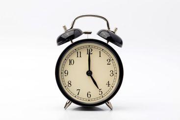 alarm clock shows five o'clock