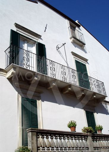 Side of house with balconies