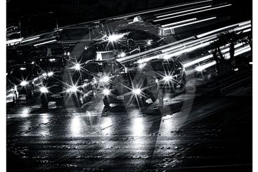 black and white image of cars on road in las vegas