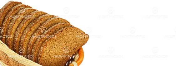 Sliced bread in a wicker basket isolated on white . Free...