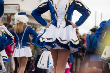 legs of girls with sexy costume of cheerleader parading...