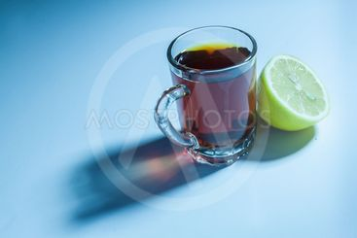Glass of black tea and slice of lemon