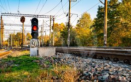 Railway traffic light of red color.
