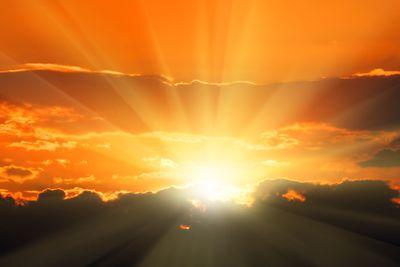 orange sunset with sunbeams