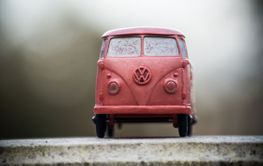 Front view of orange Volkswagen van toy miniature in...