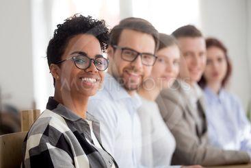 Happy multiracial team smiling looking at camera