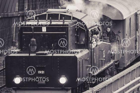 Vintage steam train departing at Stockholm cental station