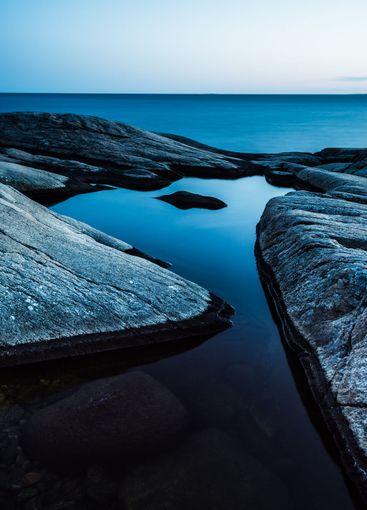 Rocky coast with blue sky and blue sea