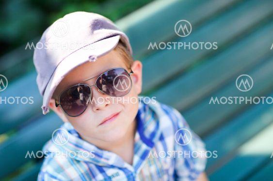 Stylish boy in sun glasses
