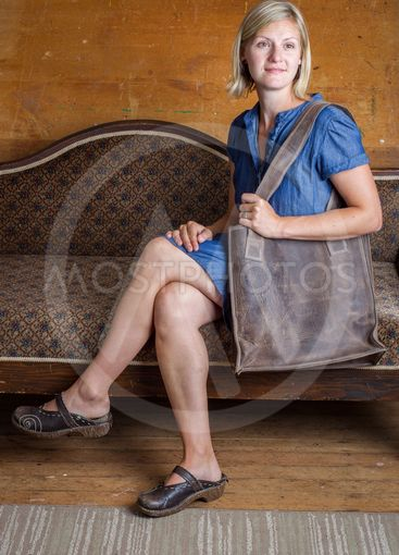 Blonde Woman with Brown Purse on Antique Couch