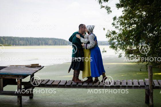 Viking family on the footbridge by the lake