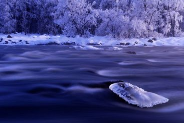 Ice on a rock in river