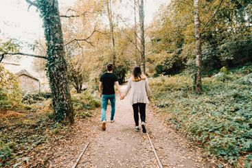 Young couple taking a active walk in the park during...