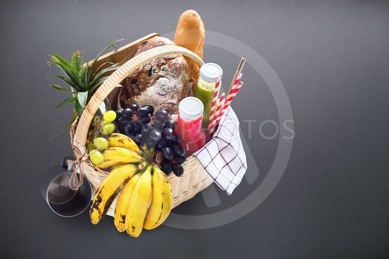 Basket filled food fruits drinks picnic summer rest