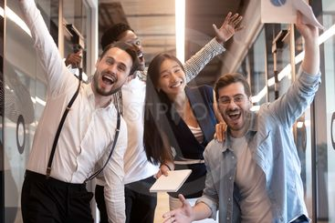 Excited funny multiethnic business team stand in office,...