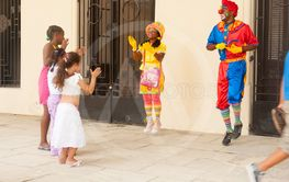 Street performance, clowns entertain children