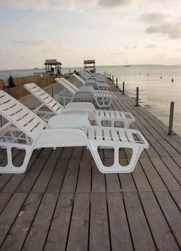 Chaise longues on pier