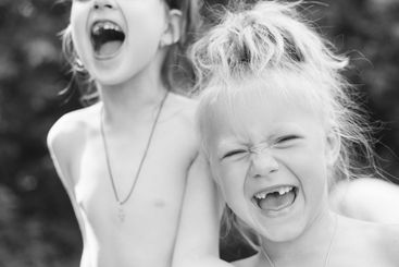 two sisters having fun and laughing together
