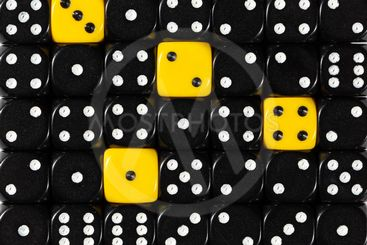 Background of random ordered black dices with four yellow...