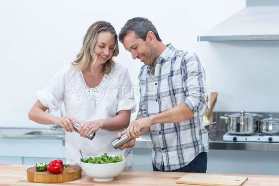 Pregnant couple in kitchen