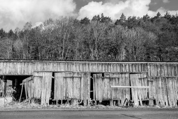 Old weathered barn with broken planks