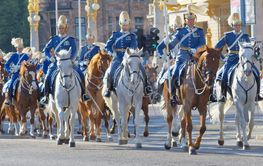 The Royal guards in blue uniforms on the horse back...