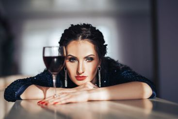 beautiful luxury woman with glass red wine