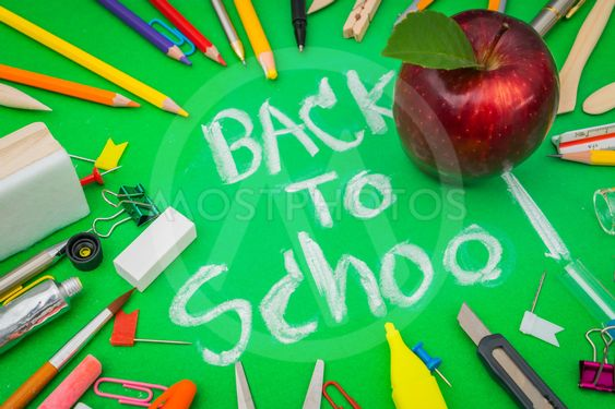 "School supplies on Green chalkboard "" Back to school..."