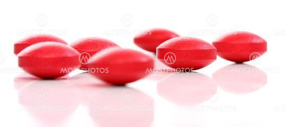 Grupp av röda medicin piller