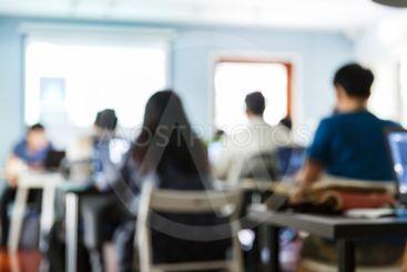 Blur people in seminar room