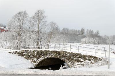 Stone Bridge under Snow