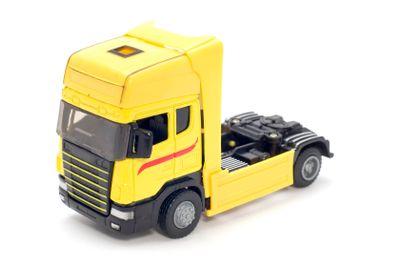 Yellow truck on white
