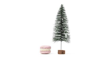 Christmas tree and french macaroon or macaron dessert on...