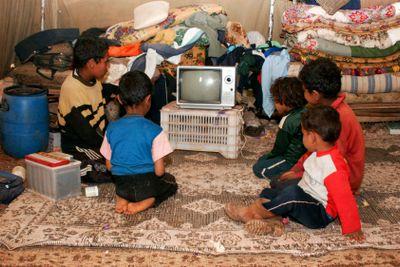 Bedouin Boys Watching Black and White TV