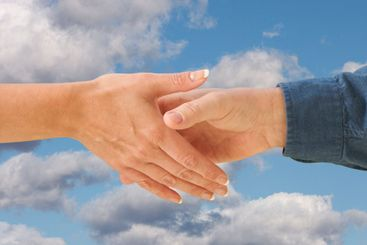Man and woman shaking hands with path.