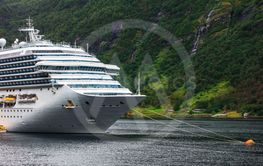 cruise liner anchored in fjord
