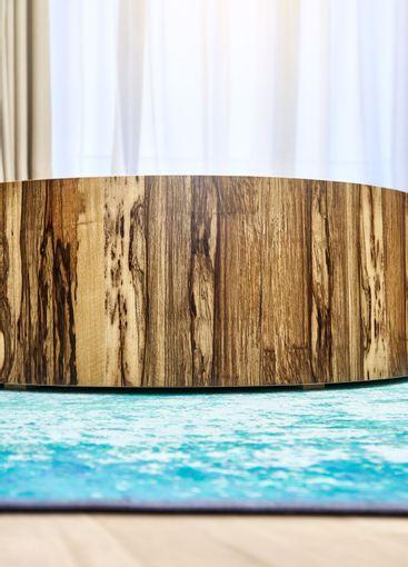Coffee table of plywood and Black Ofram veneer in room