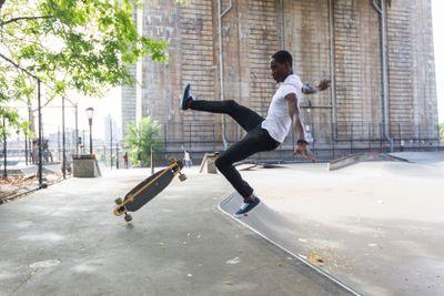 Black Boy Skating at Park and Falling Down