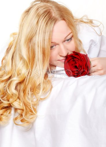 Woman In Bed With Rose