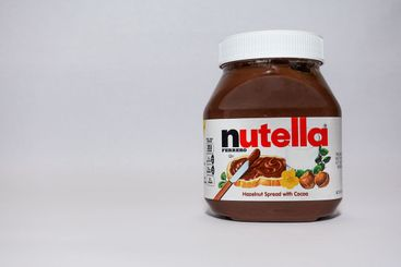 A jar of Nutella  Hazelnut Spread with Cocoa isolated on...
